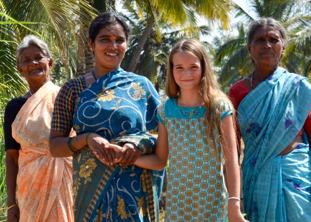 Lovena's daughter Asha with a woman farmer and her mother in India