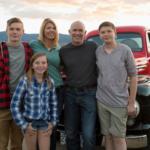 Covert Family Farm - Portrait proud family vintners in vineyard